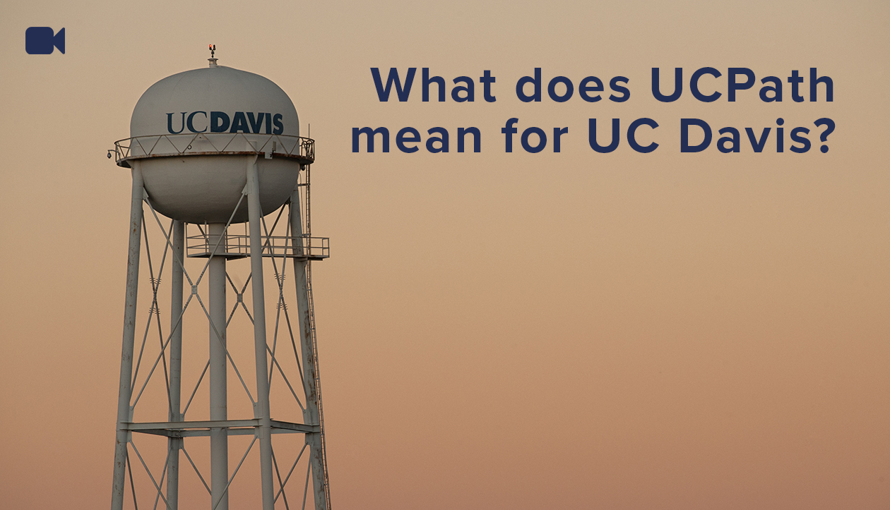 uc davis water tower at sunset linking to a video explaining what uc path means for uc davis