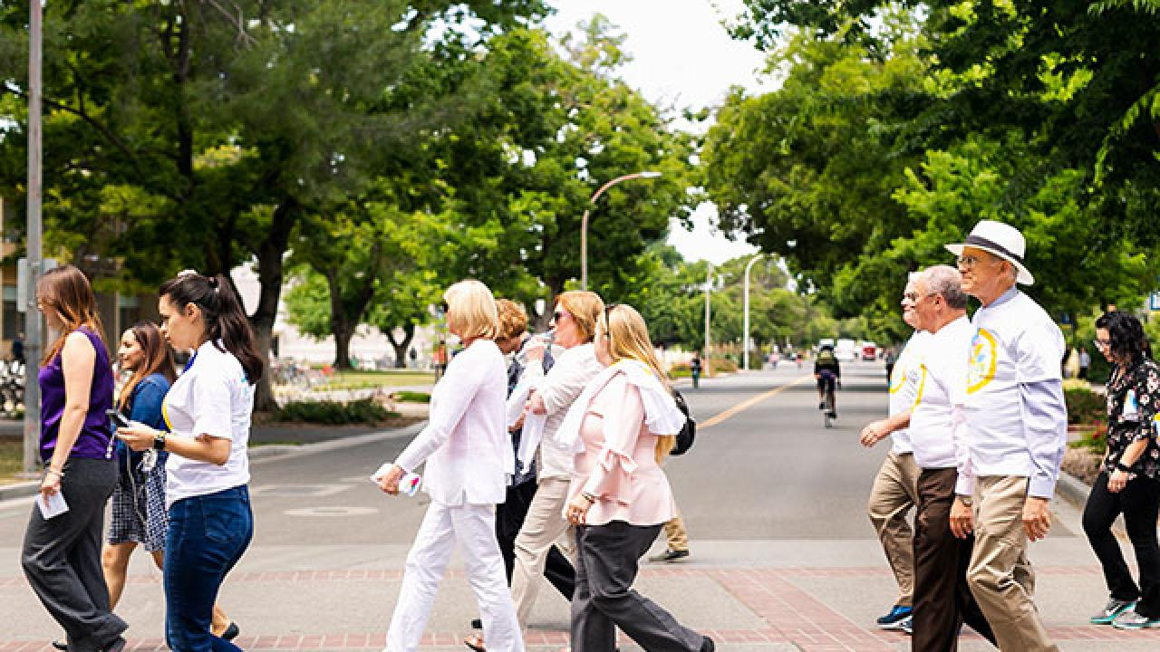 Photo of diverse group of people in a crosswalk.