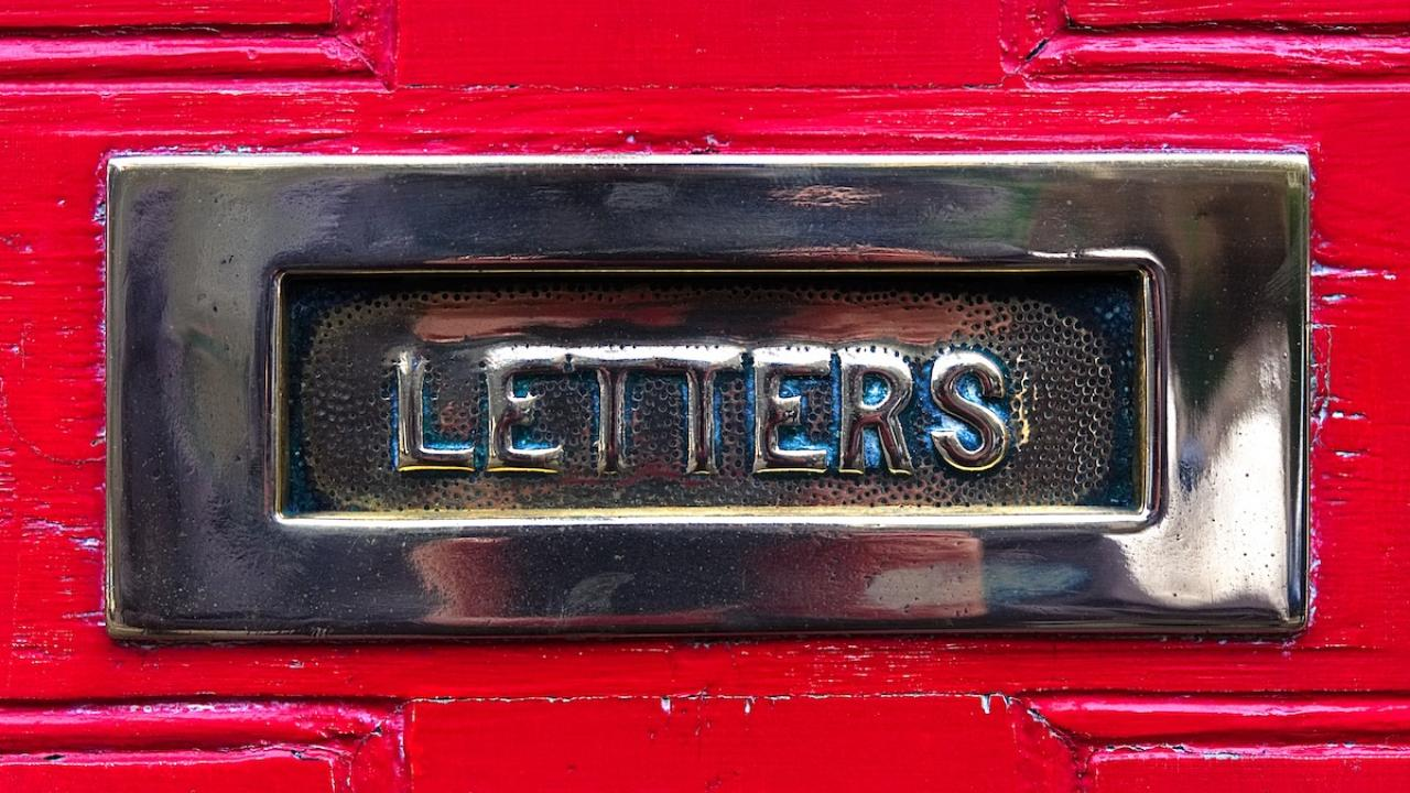 letters slot in exterior buildign for mail